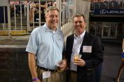 Dale Spencer, left, from OBXtek Inc., and Dennis Ainge from Neustar Inc.