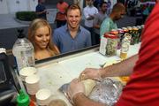 Katie and Dakota Greer watch their order being made in Rollin' Zoinks food truck.