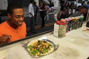 Curtis Granderson, New York Yankees outfielder, waits for a scallywag (scallop sandwich) from Rollin' Zoinks.