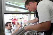 Mark Gabrick, owner of The Hogfather, serves customers in Largo.