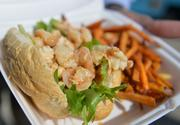 Port San Antonio workers can order a lobster po-boy for lunch at the new food-truck court.