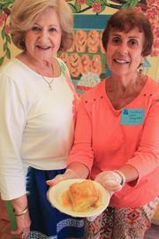Mary Soulas, left, and Chris Xeroglanes spent weeks baking delights like this Galaktoboureko for the Greek Orthodox Church bake sale.