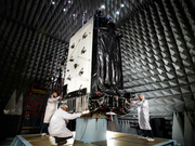 Lockheed Martin Space Systems Co. employees work on the first GPS III satellite in a testing chamber in Jefferson County. The satellites, expected to start being launched into orbit in early 2018, are more powerful replacements for the satellites that provide signals for military guidance and navigation and civilian GPS services.