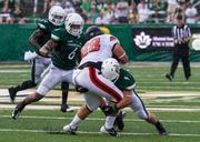 Charlotte 49ers defender Mark Hogan puts a stop on tight end Alex Green. The 49ers beat the Campbell Fighting Camels 52-7 in their inaugural football game at Jerry Richardson Stadium, on Aug. 31, 2013.