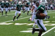 Charlotte 49ers slot receiver Corey Nesmith Jr. races past defenders on his way to the end zone for a touchdown. The 49ers beat the Campbell Fighting Camels 52-7 in their inaugural football game at Jerry Richardson Stadium, on Aug. 31, 2013.