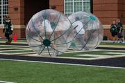 Football wasn't the only game on display. Here fans participate in a hamster-ball race. The 49ers beat the Campbell Fighting Camels 52-7 in their inaugural football game at Jerry Richardson Stadium, on Aug. 31, 2013.
