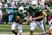 Charlotte 49ers slot receiver Austin Duke looks for running room with blocking help from quarterback Matt Johnson. The 49ers beat the Campbell Fighting Camels 52-7 in their inaugural football game at Jerry Richardson Stadium, on Aug. 31, 2013.