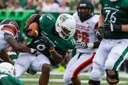 Charlotte 49ers wide receiver Mikel Hunter looks for extra yardage. The 49ers beat the Campbell Fighting Camels 52-7 in their inaugural football game at Jerry Richardson Stadium, on Aug. 31, 2013.