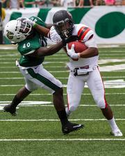 Charlotte 49ers defensive back Andy Holmes tries to make a tackle despite a stiff-arm from his opponent. The 49ers beat the Campbell Fighting Camels 52-7 in their inaugural football game at Jerry Richardson Stadium, on Aug. 31, 2013.