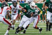 Charlotte 49ers running back Kalif Phillips tries to escape tacklers. The 49ers beat the Campbell Fighting Camels 52-7 in their inaugural football game at Jerry Richardson Stadium, on Aug. 31, 2013.