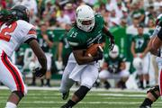Charlotte 49ers running back Kalif Phillips looks for daylight. The 49ers beat the Campbell Fighting Camels 52-7 in their inaugural football game at Jerry Richardson Stadium, on Aug. 31, 2013.