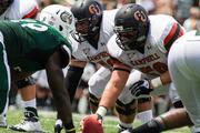 Linemen eye each other in trenches before a snap. The 49ers beat the Campbell Fighting Camels 52-7 in their inaugural football game at Jerry Richardson Stadium, on Aug. 31, 2013.