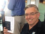 Greg Fishel, a meteorologist with Raleigh's WRAL television station, is all ready for the inaugural Paris flight.
