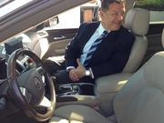 U.S. Rep. Bill Shuster (R-PA) sitting in the passenger seat of an autonomous Cadillac SRX. The vehicle drove Shuster and others 33 miles from Cranberry Township to the Pittsburgh International Airport. The car was turned autonomous at Carnegie Mellon University.