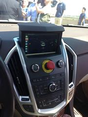 One of the few places where the car looks different than a regular Cadillac SRX is the dash where there is a display system that shows what the sensors see and a big red button that will turn off the autonomous capability.