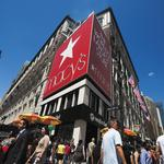 Macy's names new president, lays off 100