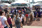 The Ravens opener wasn't in Baltimore, but that didn't stop Baltimore from showing its purple pride. Fans wait for autographs at the NFL Kickoff Village in the Inner Harbor.