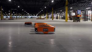 How thousands of robots improve human efficiency at Amazon's Etna facility