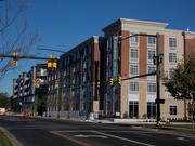 The Homewood Suites part of the project is complete, while construction continues next door.