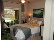 A look at the master bedroom in a two-bedroom unit at Casa Mirella apartment complex