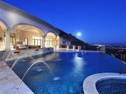 The moon rises over the pool and hot tub.