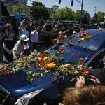 Crowds line Louisville streets to cheer, honor Muhammad Ali