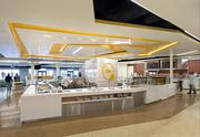 """Seen here is my favorite space -- the cafeteria. Gensler did everything you see, including the graphical treatment. The ceiling motif? It's tough to tell from this angle, but it is designed to evoke a thumbprint. The project was a highlight for Todd Merrill, a project manager at SC Builders Inc., the general contractor. """"Getting the opportunity to work on this project was very exciting,"""" he said. """"It's one of those jobs that will always stick with me."""""""