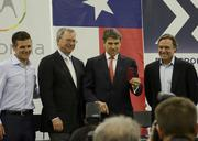 Dennis Woodside, chief executive of Motorola Mobility, Google chairman Eric Schmidt, Texas governor Rick Perry, taking a photo of the media with his new Motorola Moto X phone and Flextronics CEO Mike McNamara at the factory unveiling Tuesday.