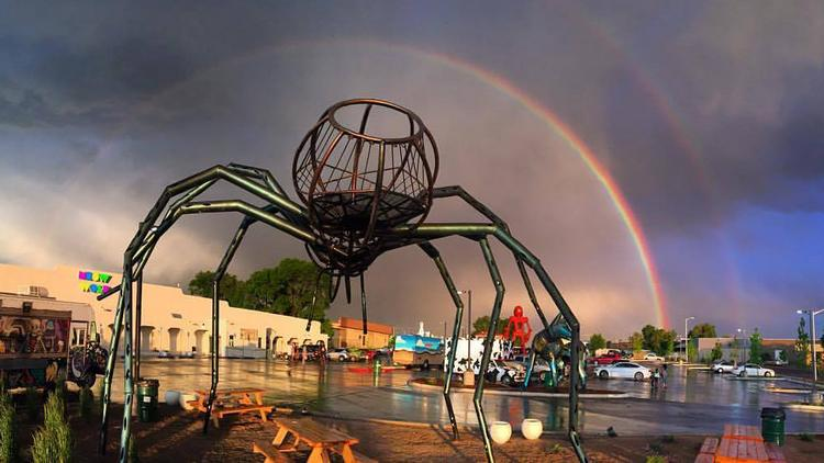 Meow Wolf is creating a $100,000 fund that will go toward supporting DIY arts and music spaces around the world. Pictured is the parking lot of Meow Wolf's House of Eternal Return.