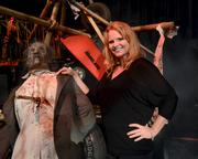 Lora Wallace of the Universal design team was responsible for the Walking Dead outdoor scare zone sets. She definitely was having fun.