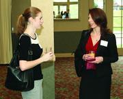 Brittany Siebart, left, of Seubert and Associates and Alyssa Kaczmarek of Capterra Risk Solutions.
