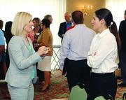 Kate Gatto, left, of Robert Morris University, and Jennifer Frazier of Kforce Inc.